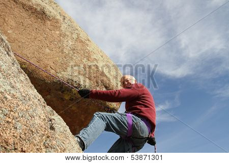 Rock climbing senior male