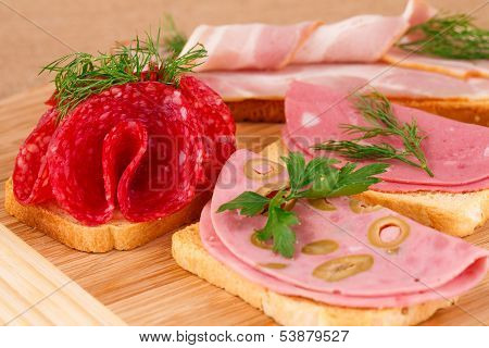 Sandwiches With Salami, Bacon And Mortadella