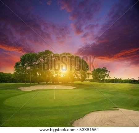 Sunset over the field of golf. island of Bali.