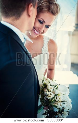 Young happy bride and groom