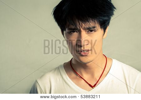 Young man looking upset