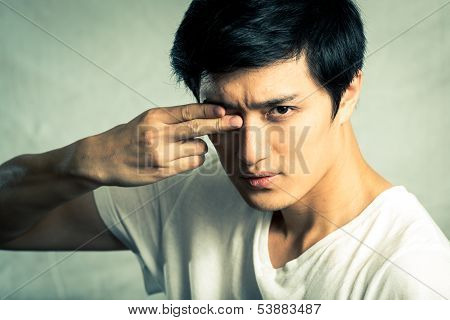 Man covering one eye