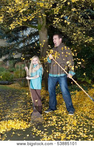 Dad And Daughter Cannot Keep Up With The Falling Leaves