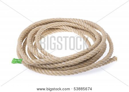 A Roll Of Sturdy Rope Material. Twisted Into A Circle. On A White Background.