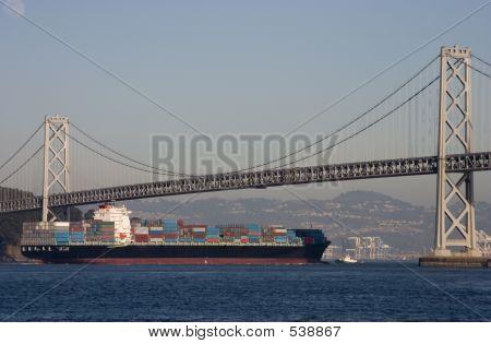 Container Ship Under Bridge