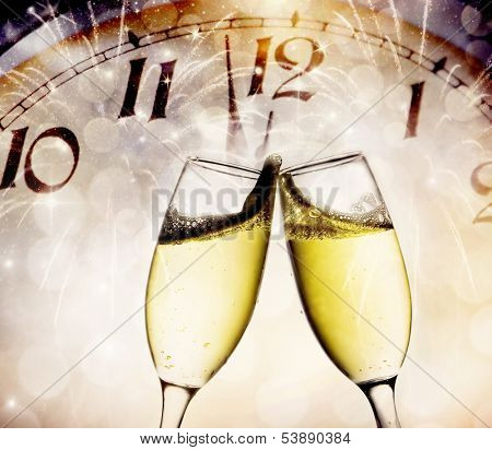 Wine glasses and clock at midnight