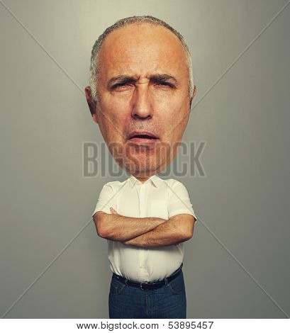 funny portrait of senior man with silly expression on his face over grey background