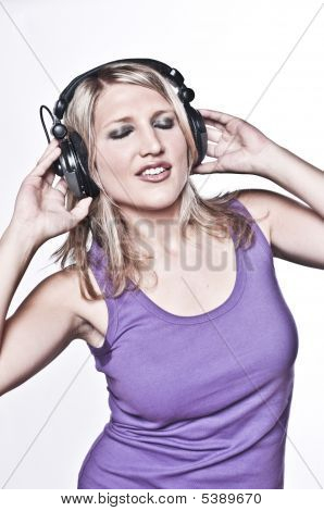 Beautiful Blond Woman Listening On Headphones