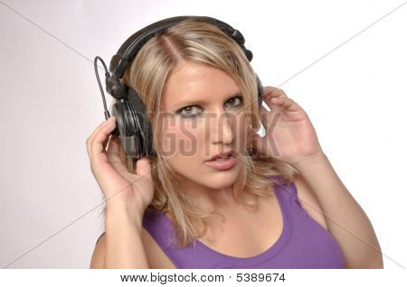 Closeup Of A Beautiful Blond Woman With Headphones