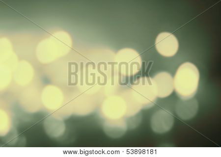 Abstract Twinkling Bokeh Background Of Defocussed Golden Lights With Sparkles. Christmas, New Year,