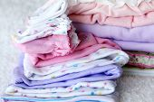 stock photo of dowry  - Lot of different baby clothes for the newborn - JPG