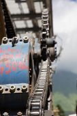 stock photo of pulley  - Chairlift mechanical pulleys in ski resort - JPG