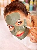 picture of beauty parlour  - Woman with clay facial mask in beauty spa - JPG