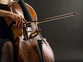 stock photo of viola  - Photo of an unrecognizable female musician playing a cello - JPG