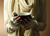 stock photo of hot-weather  - Female hands with hot drink - JPG