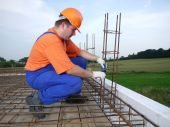 picture of bender  - Bar bender fixing steel reinforcement for house concrete floor slab - JPG