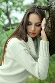 picture of pain-tree  - Portrait of young serious woman near tree - JPG