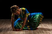 stock photo of bharatanatyam  - Young beautiful woman dancer exponent of Indian classical dance Bharatanatyam - JPG