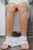 Woman With Her Panties Around Her Ankles