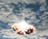 foto of hand god  - The hands of creation against a blue cloud sky - JPG