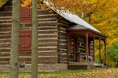 stock photo of log cabin  - an old log cabin sits on the outskirts of almelund minnesota autumn - JPG