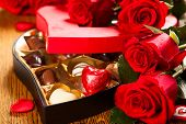stock photo of truffle  - Heart shaped box of chocolate truffles with red roses - JPG