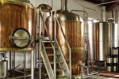 stock photo of silos  - Interior views of small micro brewery processing and storage - JPG
