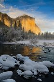 stock photo of granite dome  - View of El Capitan from the Merced RIver at sunset in the winter - JPG