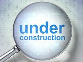 SEO web design concept: Under Construction with optical glass