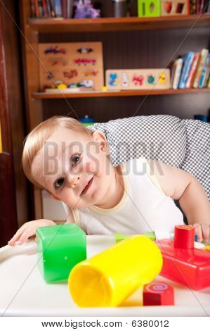 A Boy And Colorful Blocks