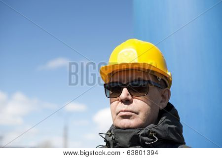 man with yellow hardhat and sunglasses