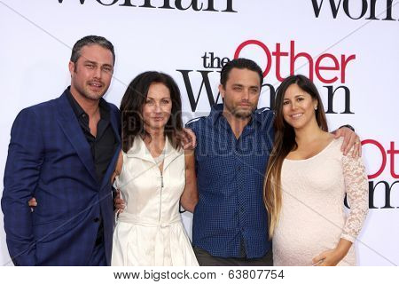 LOS ANGELES - APR 21:  Taylor Kinney, mother Pamela Heisler, and Brother and Sister in Law at the