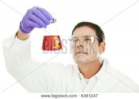 Scientist Examines Liquid Compound