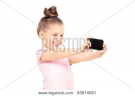 Little girl taking a selfie isolated on white background