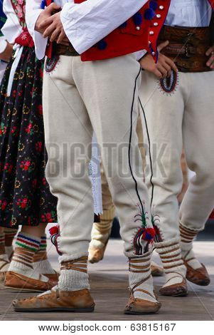 Horizontal Colour Image Of Female Polish Dancers In Traditional Folklore Costumes On Stage