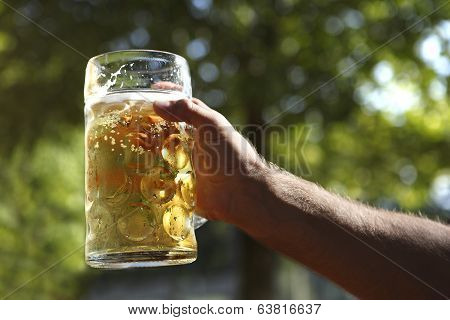 Man Holds Beer In Hand