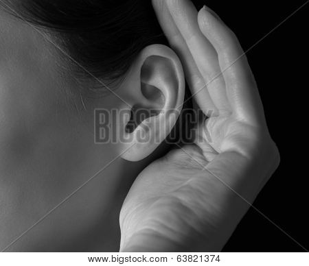 Woman Holds Her Hand Near Ear