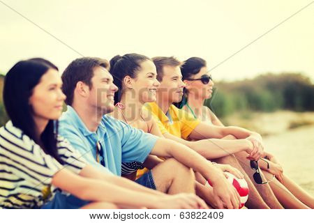 summer, holidays, vacation, happy people concept - group of friends or volleyball team having fun on the beach