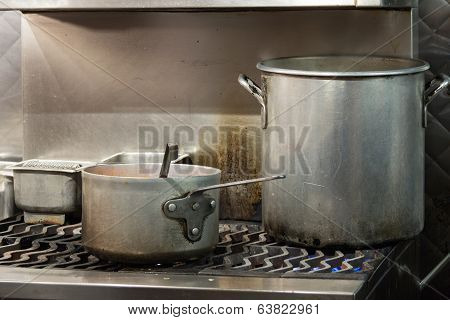Two Huge Metal Pots on a Stove