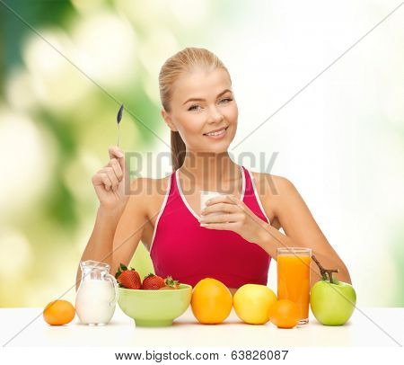 fitness, healthcare and diet concept - smiling young woman eating healthy breakfast