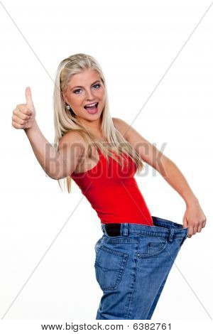 Young Woman Indicating Weight Loss Success
