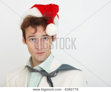 Portrait Of Young Man In Christmas Cap On White Background