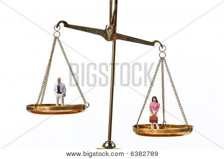Dolls On Balancing Scales