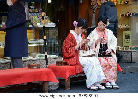 Tokyo, Japan - November 21, 2013: Young Japanese Women Wearing A Traditional Dress Called Kimono