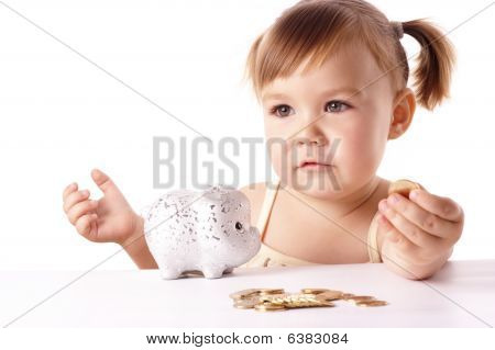 Cute Little Girl With Piggybank