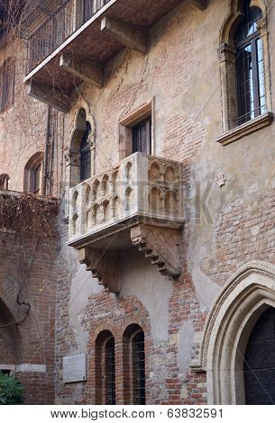 VERONA, ITALY - JANUARY 1, 2013: The balcony of Casa di Giulietta, Juliet's house where Shakespeare's character believed to live. Now it's one of the most popular tourist attraction in Verona