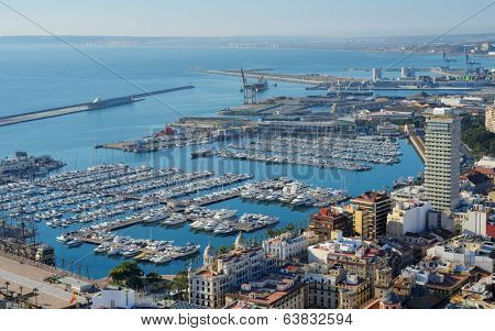 ALICANTE, SPAIN - JANUARY 8, 2013: Yachts in port of Alicante. It's one of the most important ports in Spain for cruises,  bringing some 80,000 cruise passengers and 30,000 crew to the city each year.