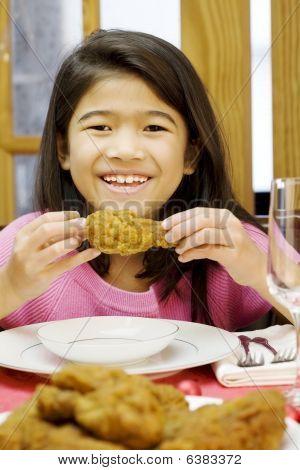 Girl Eating Fried Chicken Drumstick