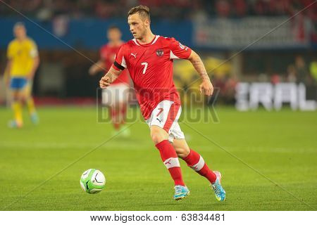 VIENNA,  AUSTRIA - JUNE  7 Marko Arnautovic (#7 Austria) runs with the ball during the world cup qualifier game on June 7, 2013 in Vienna, Austria.