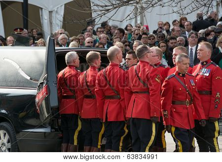 Mounties handling Jim Flaherty casket at State Funeral